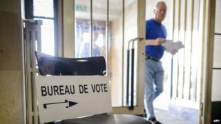 A man arrives to casts his ballot during a referendum on May 18, 2014 in Bulle, western Switzerland