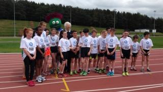 Mary Peters and children with baton relay
