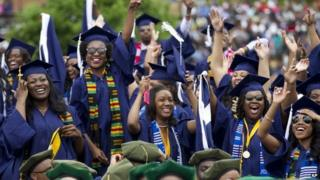 Students cheers as the class of 2014 celebrate during the graduation ceremony at Howard University in Washington 10 May 2014