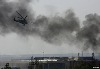 A Ukrainian helicopters gunship fires at pro-Russia gunmen at Donetsk airport - 26 May 2014
