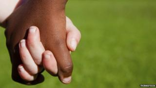 Black and white hands together
