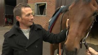 Craig Brazier patting the horse named Chatez