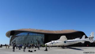 WhiteKnightTwo, carrying SpaceShipTwo, sits on display outside the hangar facility at Spaceport America, northeast of Truth Or Consequences, on October 17, 2011 in New Mexico