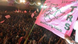 Indian supporters of Telangana hold flags and shout slogans to celebrate India's 29th state, Telangana, in Hyderabad, 2 June