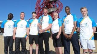 Sir Matthew Pinsent with baton bearers Baton bearers (left to right) Chris Zah, Daniel O'Sullivan, JJ Webb, Jim Howell, Ashley Cooper and Jonathan Bennett