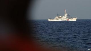 This picture taken on May 13, 2014 from a Vietnamese coast guard ship shows a Chinese coast guard vessel sailing near the area of China's oil drilling rig in disputed waters in the South China Sea.