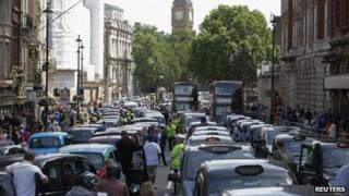 Taxi drivers block the road in Whitehall