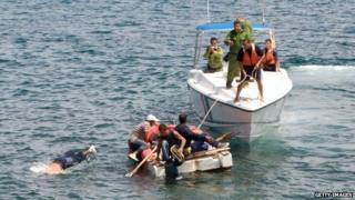 Would-be Cuban migrants are ordered by Cuban coast guards to return to the island. June 4, 2009.