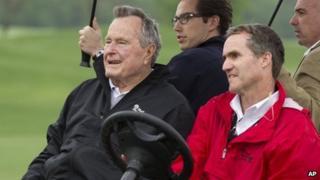 George H W Bush, left, at a golf tournament in Houston (April 2014)