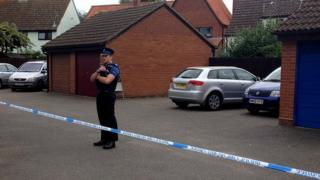 The woman's body was found inside a property in Martlesham Heath