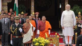 "PM Narendra Modi looks on with Bhutanese officials during a traditional ""chhipdrel"" ceremony and to greet a guard of honour in Thimphu on June 15, 2014."