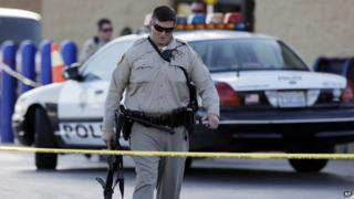 A police officer walks away from the scene of a shooting in Las Vegas on 8 June, 2014.