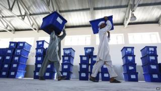 Afghan election workers carry ballot boxes at an election commission office in Jalalabad east of Kabul, Afghanistan on 12 June 2014.