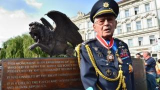 Czechoslovak war veteran Imrich Gablech, 98, poses in front of the monument in memory of Czechoslovak WW2 pilots in the British Royal Air Force (RAF), in Prague, 17 June 2014