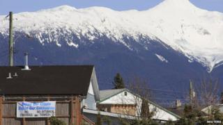 A Protest sign hangs from a building in the town of Kitimat, British Columbia 12 April 2014
