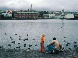 Archive picture of family gathering at Lake Tjornin in Reykjavik, feeding ducks
