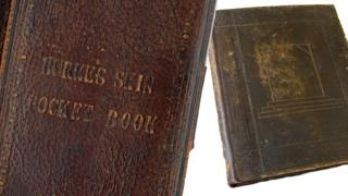 Two books bound in human skin