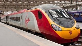 A Virgin Trains Pendolino 390137 sits on platform 2 at Glasgow Central Station