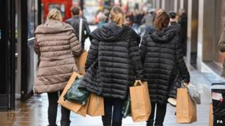Shoppers carrying bags on Oxford Street