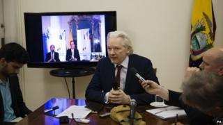 Julian Assange speaking to the media at the Ecuadorean embassy in London. 19/06/2014
