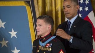 "US President Barack Obama awards the Medal of Honor to US Marine Cpl William ""Kyle"" Carpenter during a ceremony at the White House in Washington, DC 19 June 2014"