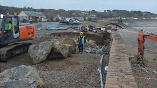 Temporary repairs being made to the breach at Vazon, Guernsey