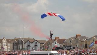 The parachutist just before impact