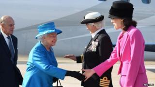 The Queen and Prince Philip are greeted by Secretary of State Theresa Villiers and Dame Mary Peters