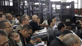 Lawyers attend the sentencing hearing for journalists working for Al-Jazeera in a courtroom in Cairo, Egypt