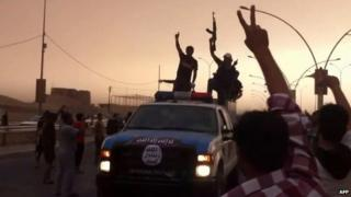 An image grab taken from a video uploaded on Youtube on June 12, 2014, allegedly shows Islamic State of Iraq and the Levant (ISIS) militants taking part in a military parade in the northern city of Mosul