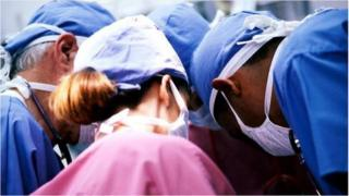 Surgeons in an operation