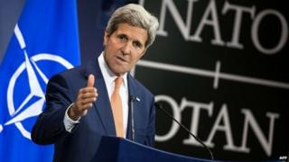 US Secretary of State John Kerry speaks during a press conference at NATO headquarters - 25 June 2014