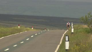 Cyclist on moorland road