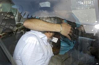 Wojciech Janowski leaves a police station in Nice, France, 27 June
