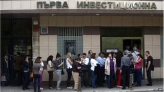 "People queue in front of a branch of Bulgaria""s First Investment Bank in Sofia on June 27, 2014"