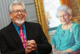 Rolf Harris with his portrait