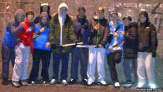 Gang brandishing weapons