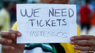 """A fan holds a """"We Need Tickets"""" sign prior to the 2014 FIFA World Cup Brazil Group F match between Argentina and Bosnia-Herzegovina at Maracana on 15 June, 2014"""