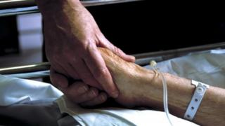 Holding a patient's hand