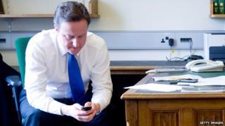 David Cameron with mobile phone