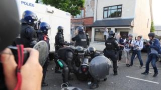 Police were attacked by loyalists in the Woodvale area of north Belfast on 12 July 2013 after the same parade was restricted