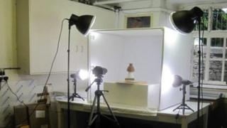 Ancient Egyptian artefact being photographed