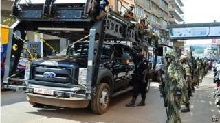 UPDF soldiers and police forces patrol streets in Kampala with a tactical operation vehicle on July 3