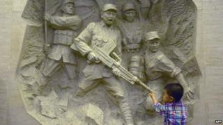 A boy visits China's Anti-Japanese War museum in west Beijing