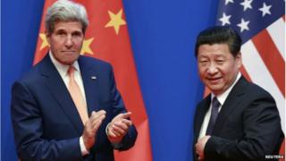 US Secretary of State John Kerry (L) applauds after China's President Xi Jinping gave his speech during the opening ceremony of the Sixth Round of US-China Strategic and Economic Dialogue at Diaoyutai State Guesthouse in Beijing on 9 July 2014.