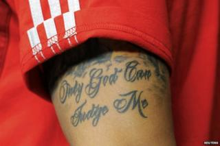"Mesut Ozil's tattoo reads ""Only God can judge me"""