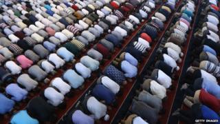 Many Muslim men knelt down in prayer