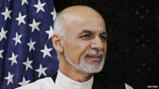 Afghan presidential candidate Ashraf Ghani Ahmadzai meets with U.S. Secretary of State John Kerry meets with at the U.S. Embassy in Kabul, Friday, July 11