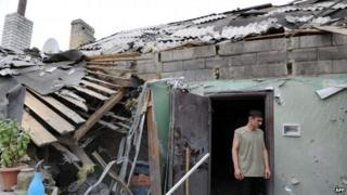 Man in doorway of house in suburb of Donetsk, Ukraine bombed on Friday and Saturday - photo 13 July