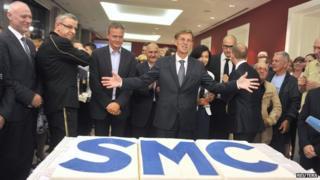 Miro Cerar, centre, with victorious SMC aides, 13 Jul 14